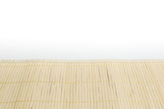 Brown bamboo mat on white kitchen table Stock Images