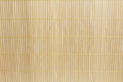 Brown bamboo mat on white kitchen table background Royalty Free Stock Photos