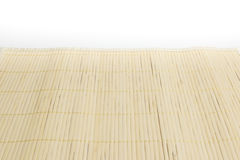 Brown bamboo mat on white kitchen table background Stock Photos