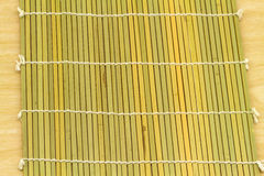 Brown bamboo weave for roll of sushi use for  background. Brown bamboo weave for roll of sushi Royalty Free Stock Image