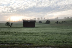 Brown Barn House Near Green Trees during Sunset Royalty Free Stock Image