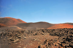 Brown and barren lava desert landscape on spanish canary island Lanzarote Royalty Free Stock Photography