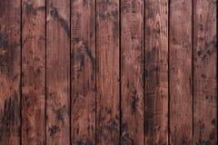 Brown, barrière de conseil en bois Panneaux en bois de vintage foncé Milieux et barrière de textures peinte Front View attirez Image stock