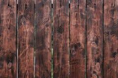 Brown, barrière de conseil en bois Panneaux en bois de vintage foncé Milieux et barrière de textures peinte Front View Attirez a Images libres de droits