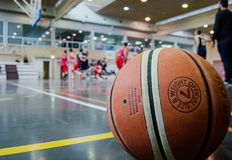 Brown Basketball on Grey Floor Stock Image