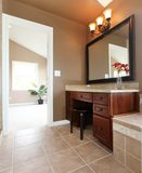 Brown bathroom interior with make up desk. Stock Image