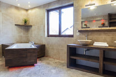 Brown bathroom in modern house Stock Photography