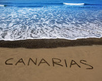 Brown beach sand with written word Canarias. In Canary islands Royalty Free Stock Photos