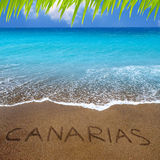 Brown beach sand with written word Canarias. In Canary islands Royalty Free Stock Photography