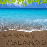 Brown beach sand written word Canary islands. Brown beach sand with written word Canary islands Royalty Free Stock Photo