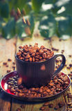Brown beans pouring coffee cup Stock Photo