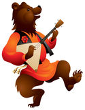 Brown bear with Balalaika. Brown bear playing music on the Russian traditional musical instrument Balalaika and dancing, fairy tales and folklore character in Royalty Free Stock Photos