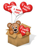 A brown bear in a box. With some hearts Royalty Free Stock Photography