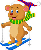 Brown bear cartoon skiing Royalty Free Stock Photos