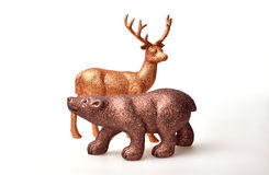 Brown bear and golden deer. Toy on white background Stock Image