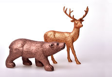 Brown bear and golden deer. Toy on white background Royalty Free Stock Images