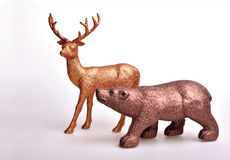 Brown bear and golden deer. Toy on white background Royalty Free Stock Photos