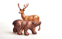 Brown bear and golden deer. Toy on white background Royalty Free Stock Photo