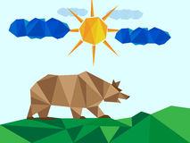 Brown bear on landscape with sun and clouds Royalty Free Stock Photography