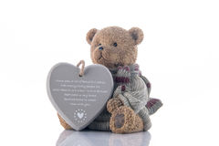 Brown bear money-box with heart Royalty Free Stock Image