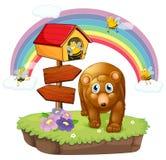A brown bear near the pethouse and the arrow board Royalty Free Stock Photos
