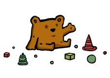 Brown the bear sits near to toys Stock Image