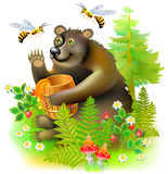 Brown bear sitting in the forest with a barrel of honey. Royalty Free Stock Photo
