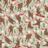 Brown bear in winter sport.Seamless pattern or bac. Brown bear plays a winter sport. Forest motives,Christmas trees,snowflakes.Seamless pattern or background.Use Royalty Free Stock Photos