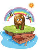 A brown bear and the wooden boat Stock Photos