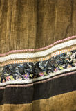 Brown beautifuly décoré du tissu de vintage de fleurs Origina Image stock