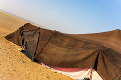 Brown Bedouin tent in the desert Stock Photography
