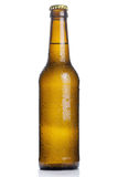 Brown beer bottle with drops isolated on white Royalty Free Stock Images