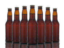 Brown Beer Bottles Over White Royalty Free Stock Photos