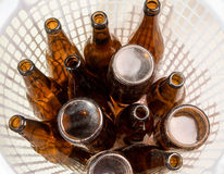 Brown beer bottles stacked isolated on white background Stock Photos