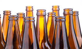 Brown beer bottles stacked isolated on white background Stock Photo