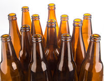 Brown beer bottles stacked isolated on white background Stock Images