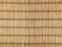 Brown beige bamboo wood mat background texture. Beige and brown natural wooden braided bamboo mat background texture with vertical planks and dark horizontal Stock Image
