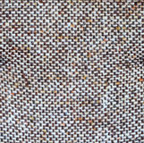 Brown and beige burlap fiber. Close-up of a brown and beige burlap textured fiber Royalty Free Stock Images