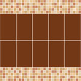 Brown and beige ceramic tile mosaic in swimming pool. Royalty Free Stock Images