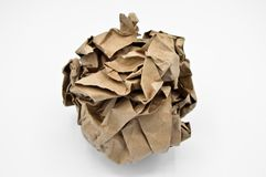 Brown and beige crumpled paper ball. Isolated on white background stock photo