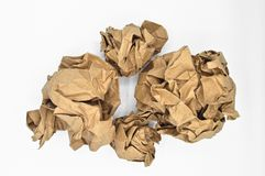 Brown and beige crumpled paper ball. Isolated on white background royalty free stock photography