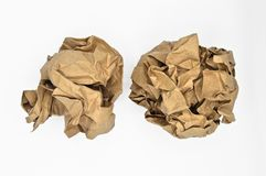 Brown and beige crumpled paper ball. Isolated on white background royalty free stock photo