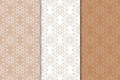 Brown and beige floral backgrounds. Brown and beige set of floral backgrounds. Set of seamless patterns for textile and wallpapers Stock Image