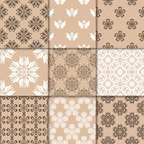 Brown beige floral ornaments. Collection of seamless patterns Royalty Free Stock Photography