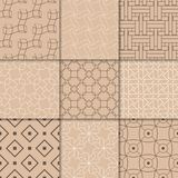 Brown beige geometric ornaments. Collection of seamless patterns. For web, textile and wallpapers Royalty Free Stock Photo