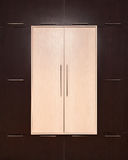 Brown and beige. modern wooden wardrobe. closed Stock Photography