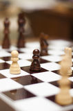 Pawn on the chessboard Royalty Free Stock Photo