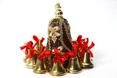 Brown bell  and a lot of little bells around the Royalty Free Stock Photos
