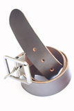 Brown belt. A brown leather belt on white stock photo