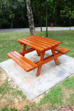 Brown bench. New brown color bench at a recreation park royalty free stock images